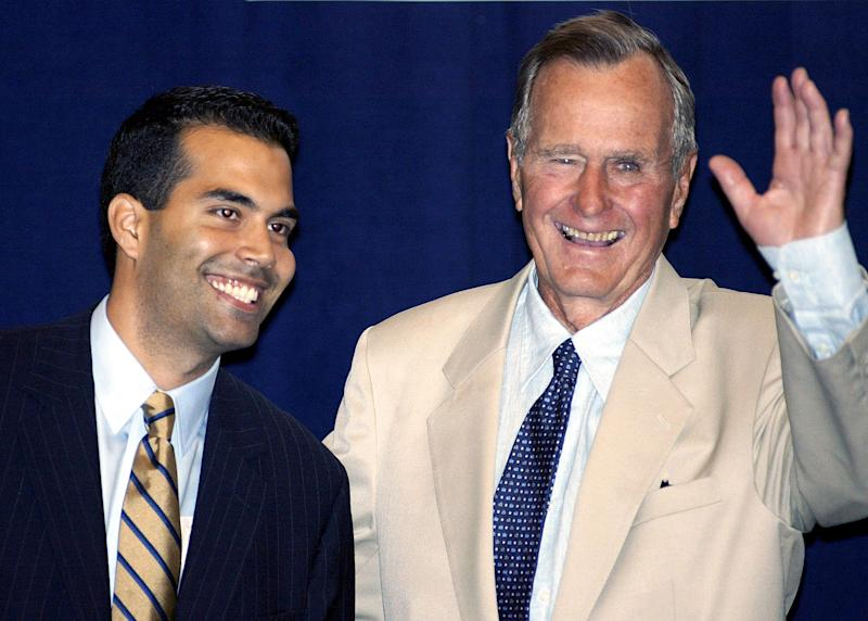In this Aug. 31, 2004 file photo George P. Bush, left, stands with his grandfather, former President George H.W. Bush, in New York prior to their remarks at a reception hosted by the Hispanic Alliance for Progress Institute in conjunction with the Republican National Convention.