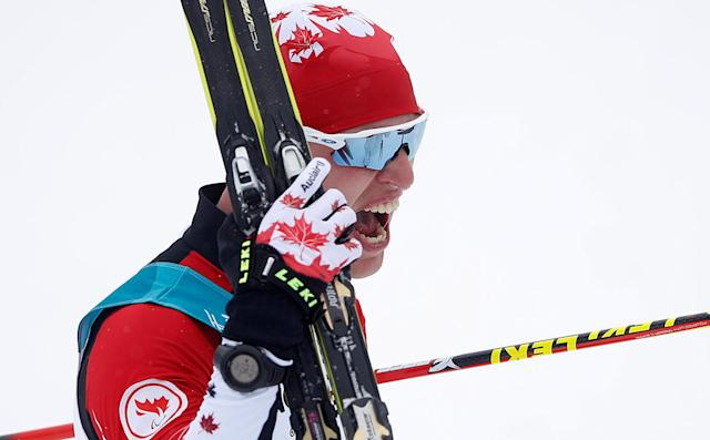 Biathlon - Pyeongchang 2018 Winter Paralympics - Men's 15km - Standing - Alpensia Biathlon Centre - Pyeongchang, South Korea - March 16, 2018 - Mark Arendz of Canada celebrates winning gold. REUTERS/Carl Recine