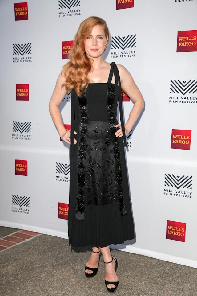 <p>Amy donned a black Prada number, complete with an embroidered panel. <i>[Photo: Getty]</i></p>