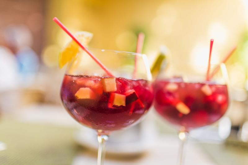 Two refreshing glasses of sangria with fruits, waiting to be savored.