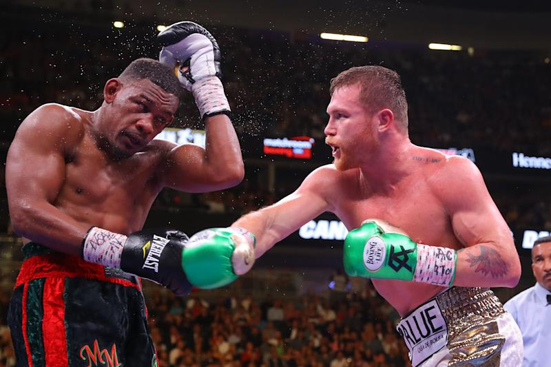 LAS VEGAS, NEVADA - MAY 04: Canelo Alvarez (R) punches Daniel Jacobs during their middleweight unification fight at T-Mobile Arena on May 04, 2019 in Las Vegas, Nevada. (Photo by Tom Hogan/Golden Boy/Golden Boy/Getty Images)