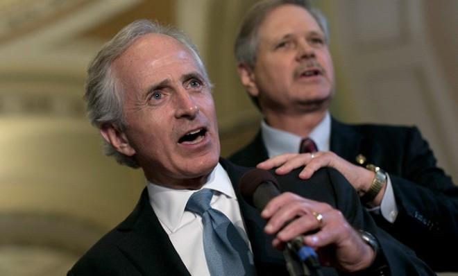 Bob Corker and John Hoeven discuss their border-security agreement on June 20.