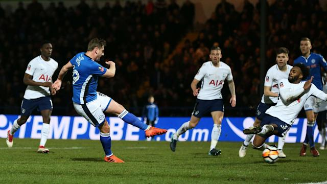 Rochdale hero Steve Davies hailed the League One strugglers' spirit after they snatched a famous FA Cup draw against Tottenham.