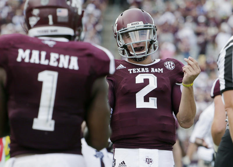 Texas A&M's Johnny Manziel (2) celebrates a touchdown with teammate Ben Malena (1) during the fourth quarter of an NCAA college football game against Rice, Saturday, Aug. 31, 2013, in College Station, Texas. (AP Photo/Eric Gay)