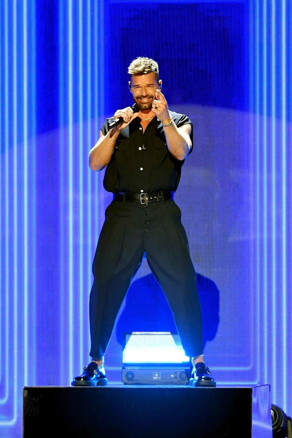 Ricky Martin, shown performing in Coral Gables, Fla., in July, is embarking on a joint tour with fellow Latin superstar Enrique Iglesias.