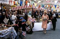 <p>Bright bunting and waving flags welcome Queen Elizabeth II to Guernsey for a state visit. (PA Archive) </p>