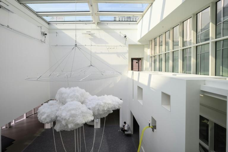 Hong Kong artist Keith Lam Yan Kit's 'Landscape of Cloud' (L) is one of the exhibits at the Hong Kong Museum of Art