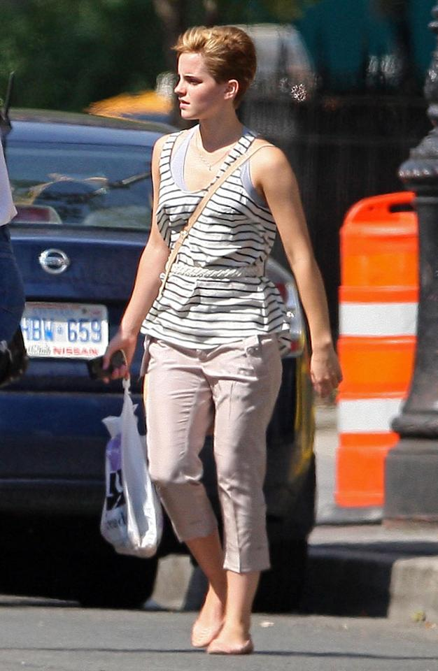 """""""Harry Potter"""" actress Emma Watson chopped off her long locks! Spotted hailing a cab in NYC Monday, the young star showed off her cute pixie crop. """"Yes, I cut my hair off a few days ago! I love it -- feels incredible,"""" she tweeted Thursday. """"Hope you like it! x."""" Flynet"""