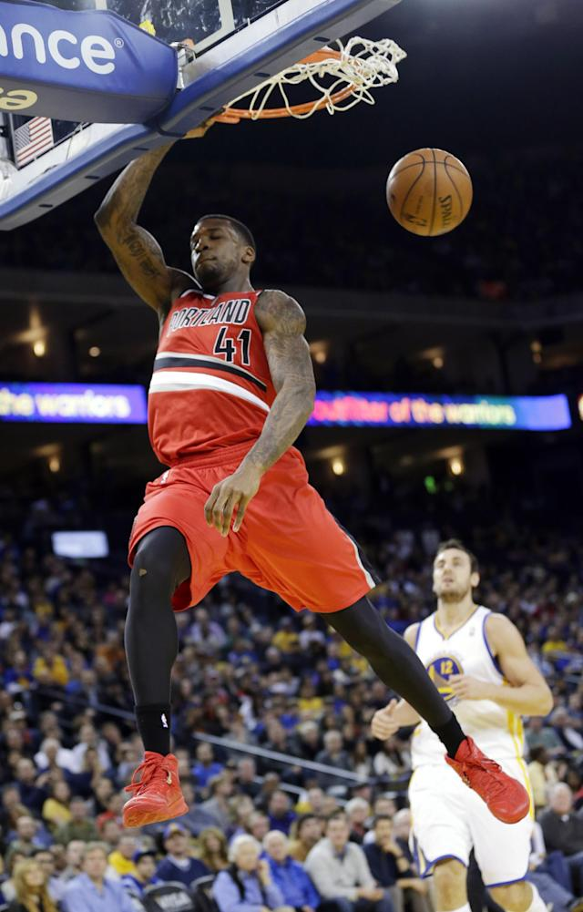 Portland Trail Blazers' Thomas Robinson (41) dunks against the Golden State Warriors during the first half of an NBA basketball game on Sunday, Jan. 26, 2014, in Oakland, Calif. (AP Photo/Marcio Jose Sanchez)