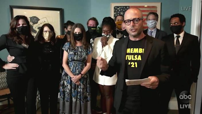"Damon Lindelof, accepting the limited series Emmy for ""Watchmen,"" wears a shirt that says ""Remember Tulsa '21,"" in commemoration of the 1921 race massacre that took place in Tulsa and was a touchstone for the series. <span class=""copyright"">(ABC)</span>"