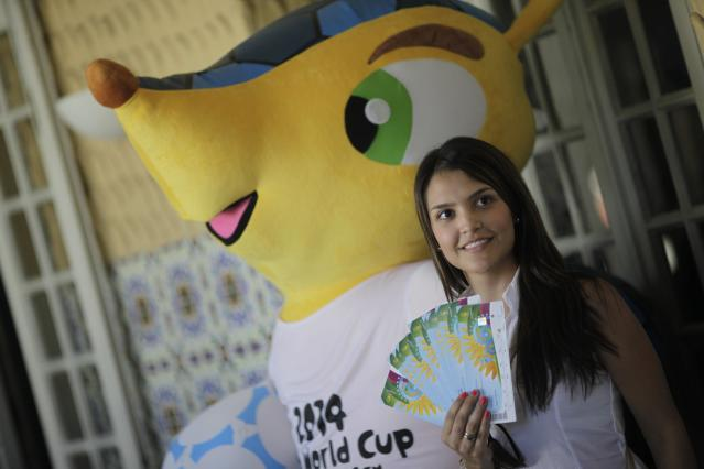 Colombia soccer fan Suzana poses after picking up her 2014 World Cup tickets in Rio de Janeiro April 18, 2014. FIFA Venue Ticketing Centres were opened in the 2014 FIFA World Cup Host Cities. REUTERS/Ricardo Moraes (BRAZIL - Tags: SPORT SOCCER WORLD CUP)