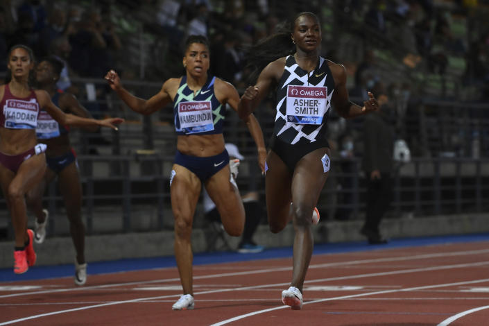 Britain's Dina Asher-Smith, right, wins the women's 200 meters event at the Diamond League track and field meeting in Florence, Italy, Thursday, June 10, 2021. (Alfredo Falcone/LaPresse via AP)