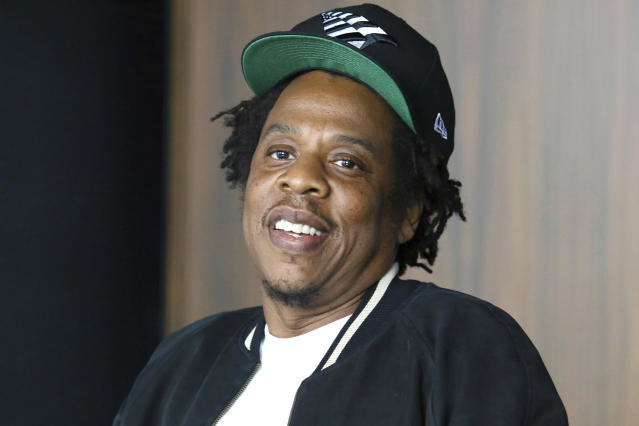 FILE - In this July 23, 2019, file photo, Jay-Z makes an announcement of the launch of Dream Chasers record label in joint venture with Roc Nation, at the Roc Nation headquarters in New York. The NFL and Jay-Zs entertainment and sports representation company are teaming up for events and social activism. The league not only will use Jay-Zs Roc Nation to consult on its entertainment presentations, including the Super Bowl halftime show, but will work with the rapper and entrepreneurs company to strengthen community through music and the NFL's Inspire Change initiative. (Photo by Greg Allen/Invision/AP, File)