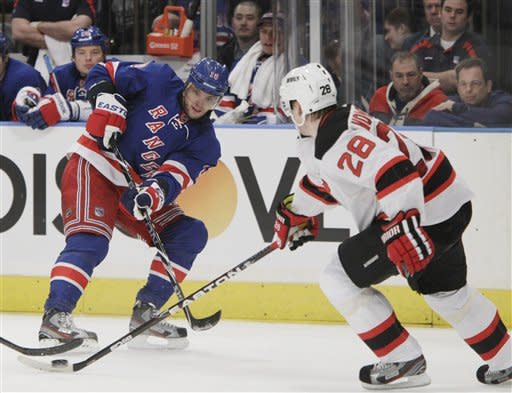 New York Rangers right wing Marian Gaborik (10) reacts after a pass that wound up in control of New Jersey Devils defenseman Anton Volchenkov (28) in the second period of their NHL hockey game at Madison Square Garden in New York, Monday, Feb. 27, 2012. (AP Photo/Kathy Willens)