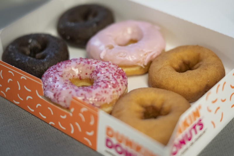 FILE - In this Feb. 6, 2019, photo a box of Dunkin' Donuts is displayed in New York. Dunkin' Brands Group Inc. reports financial earns on Thursday, Oct. 31. (AP Photo/Mark Lennihan, File)