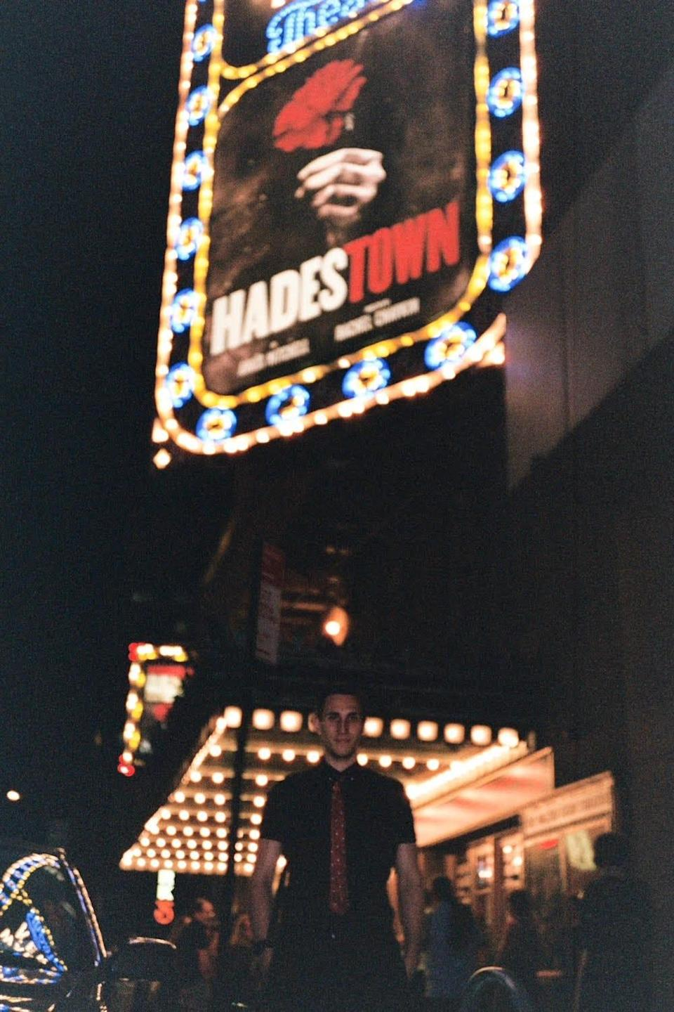 """Krause stands in front of the """"Hadestown"""" marquee. """"It's a really difficult career as it is, without having to contend with, will it come back? How will it come back?"""" Krause said."""
