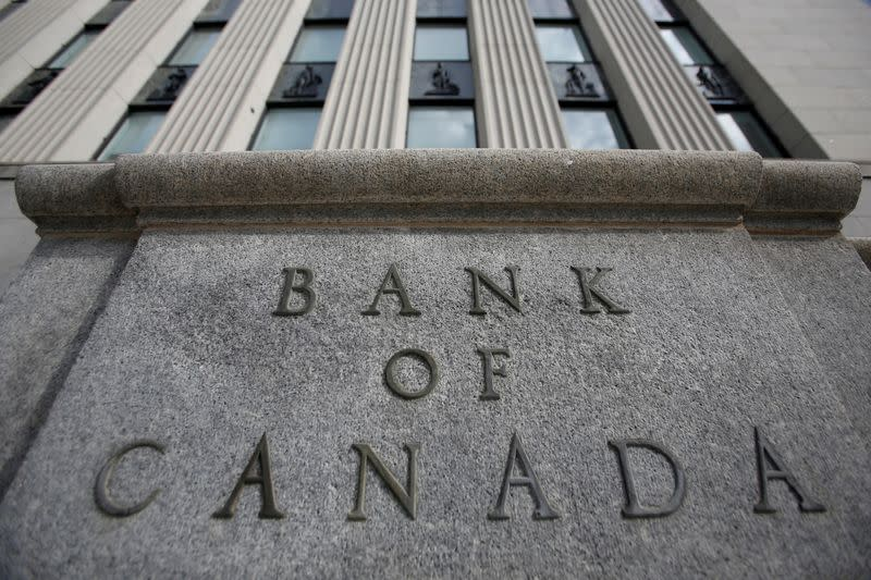 Bank of Canada holds rates, sees signs global economy is stabilizing; C$ firms