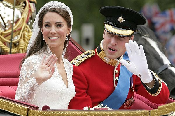 <b>7. Prince William & Catherine Middleton: </b>Catherine, Duchess of Cambridge and Prince William, Duke of Cambridge travel down The Mall on route to Buckingham Palace in a horse drawn carriage following their wedding at Westminster Abbey on April 29, 2011 in London, England.