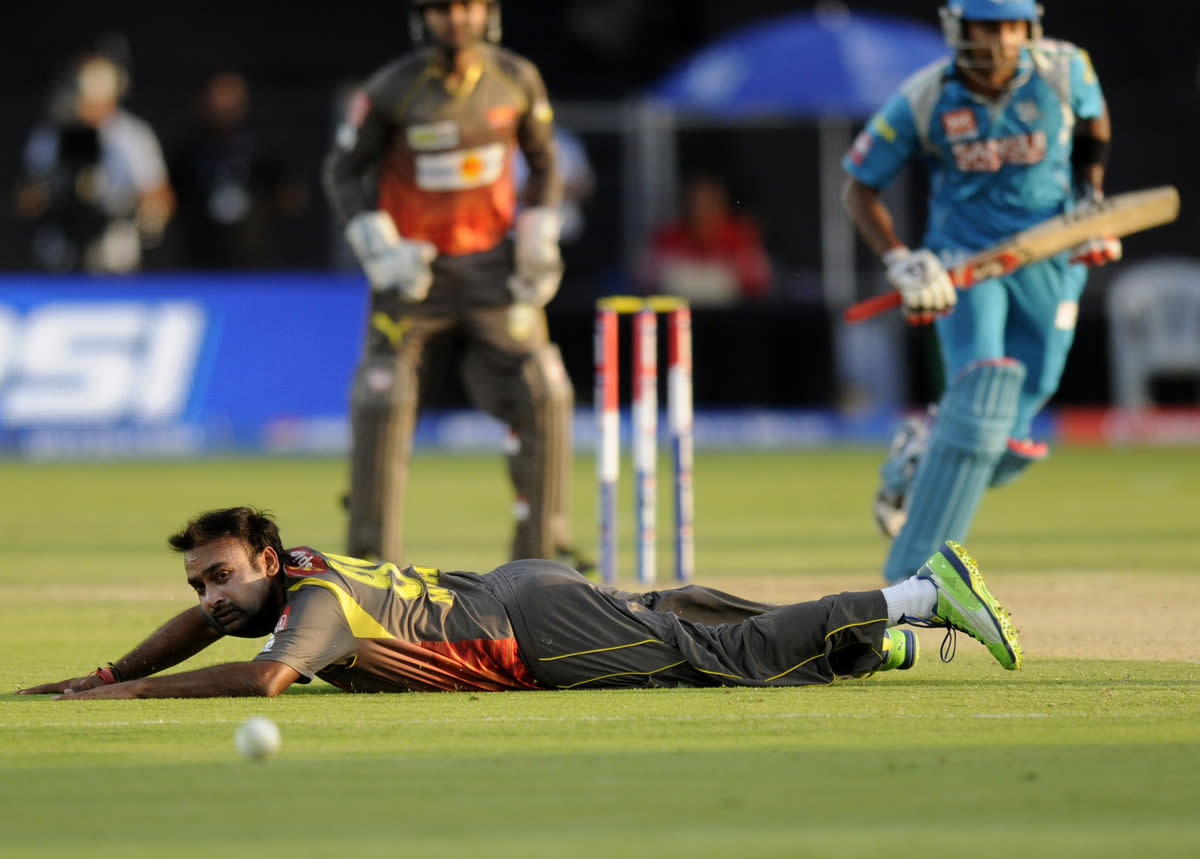 Amit Mishra of Sunrisers Hyderabad tries to stop a ball of his own bowling during match 22 of the Pepsi Indian Premier League ( IPL) 2013  between The Pune Warriors India and the Sunrisers Hyderabad held at the Subrata Roy Sahara Stadium, Pune on the 17th April  2013..Photo by Pal Pillai-IPL-SPORTZPICS ..Use of this image is subject to the terms and conditions as outlined by the BCCI. These terms can be found by following this link:..https://ec.yimg.com/ec?url=http%3a%2f%2fwww.sportzpics.co.za%2fimage%2fI0000SoRagM2cIEc&t=1503524739&sig=GQ8MmMVEYRDe7koYWum95A--~D