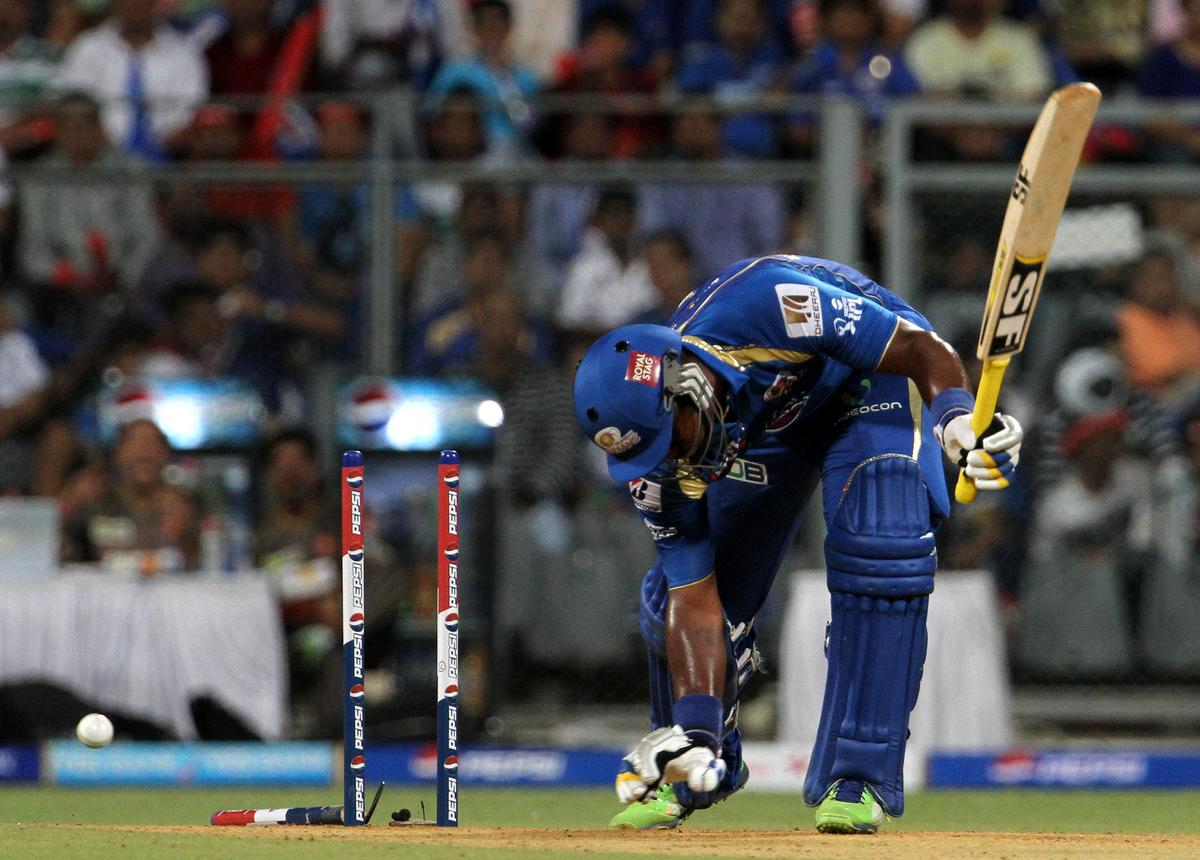 Mumbai Indian player Dwayne Smith gets bowled during match 62 of the Pepsi Indian Premier League ( IPL) 2013  between The Mumbai Indians and the Sunrisers Hyderabad held at the Wankhede Stadium in Mumbai on the 13th May 2013 ..Photo by Vipin Pawar-IPL-SPORTZPICS  ..Use of this image is subject to the terms and conditions as outlined by the BCCI. These terms can be found by following this link:..https://ec.yimg.com/ec?url=http%3a%2f%2fwww.sportzpics.co.za%2fimage%2fI0000SoRagM2cIEc&t=1490837499&sig=NX.MrJ0GLnwI5ZhaG5RkSA--~C
