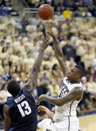 Pittsburgh's Dante Taylor (11) shoots over Villanova's Mouphtaou Yarou (13) in the first half of an NCAA college basketball game on Sunday, March 3, 2013, in Pittsburgh. (AP Photo/Keith Srakocic)