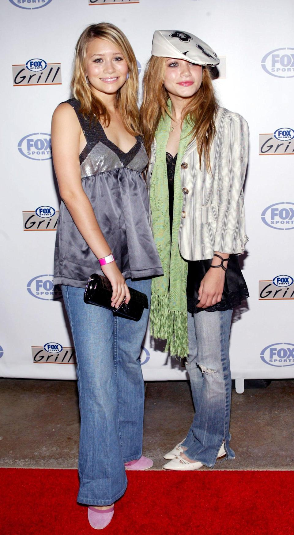 """<p>Sure, you might still be in denial, but the fact is, flare jeans are in again. We all became obsessed with them while watching <a href=""""https://www.popsugar.com/fashion/Mary-Kate-Ashley-Olsen-Style-Evolution-46225090"""" class=""""link rapid-noclick-resp"""" rel=""""nofollow noopener"""" target=""""_blank"""" data-ylk=""""slk:Mary-Kate and Ashley Olsen"""">Mary-Kate and Ashley Olsen</a> in <strong>Holiday in the Sun</strong>, and many stars like <a class=""""link rapid-noclick-resp"""" href=""""https://www.popsugar.com/Victoria-Beckham"""" rel=""""nofollow noopener"""" target=""""_blank"""" data-ylk=""""slk:Victoria Beckham"""">Victoria Beckham</a> and Gigi Hadid have already fully embraced this resurgence - so now might be a good time to <a href=""""https://www.popsugar.com/buy?url=https%3A%2F%2Fwww.kohls.com%2Fproduct%2Fprd-3827297%2Fwomens-popsugar-high-waisted-kick-flare-corduroy-pants.jsp&p_name=get%20yourself%20a%20new%20pair&retailer=kohls.com&evar1=fab%3Aus&evar9=46439730&evar98=https%3A%2F%2Fwww.popsugar.com%2Ffashion%2Fphoto-gallery%2F46439730%2Fimage%2F46450289%2FMary-Kate-Ashley-Olsen-Flare-Jeans&list1=mary-kate%20olsen%2Cashley%20olsen%2Ctrends%2Ccelebrity%20style%2Cnostalgia&prop13=api&pdata=1"""" rel=""""nofollow noopener"""" class=""""link rapid-noclick-resp"""" target=""""_blank"""" data-ylk=""""slk:get yourself a new pair"""">get yourself a new pair</a>.</p>"""