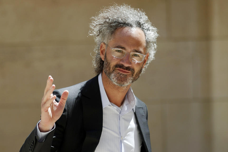 FILE - In this Wednesday, May 15, 2019, file photo, Palantir CEO Alex Karp arrives for the Tech for Good summit in Paris. Palantir Technologies Inc., a data-mining company with deep ties to U.S. intelligence and military agencies, has shed a good deal of its trademark secrecy about its business in filing for a Wall Street stock offering, on Tuesday, Aug. 25, 2020. (AP Photo/Thibault Camus, File)
