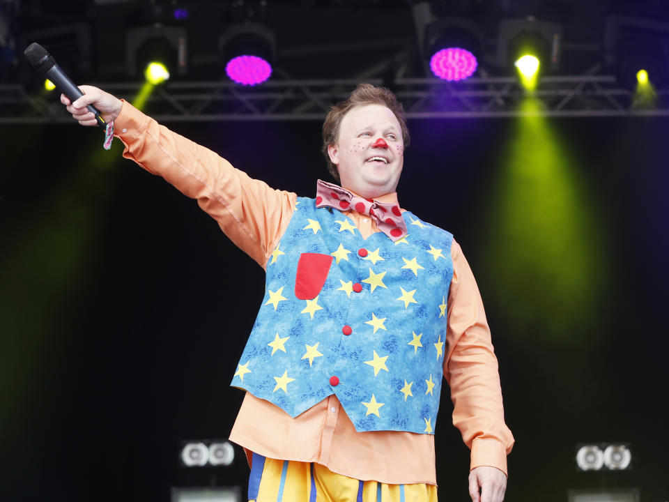 Justin Fletcher performs as Mr. Tumble at Camp Bestival at Lulworth Castle on Saturday, August 2, 2014, in Dorset, England. Thousands of music fans have arrived to the festival to see headliners James, De La Soul and Basement Jaxx. (Photo by Jim Ross/Invision/AP Images)