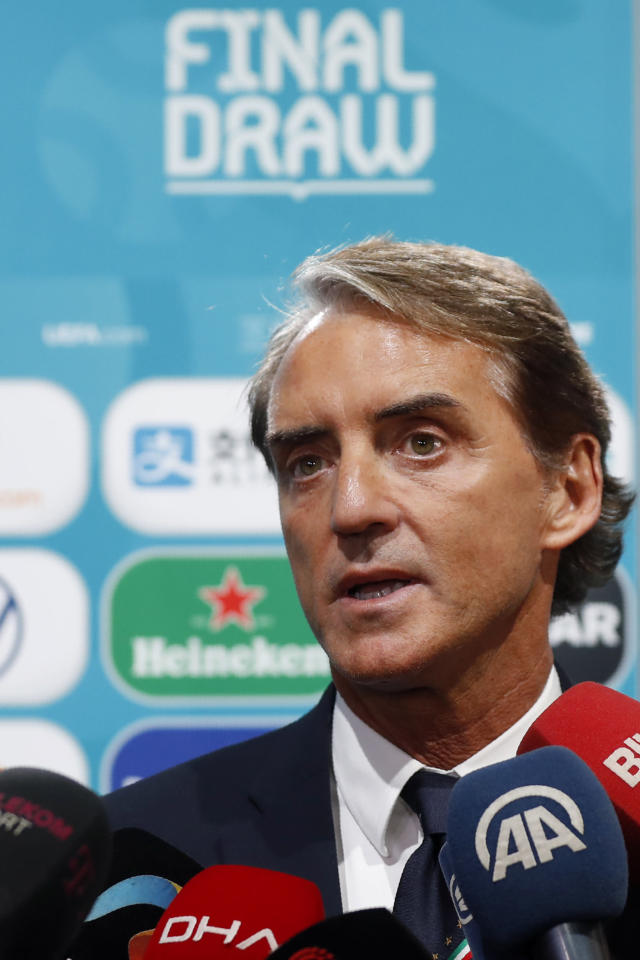 Italy coach Roberto Mancini talks to journalists after the draw for the UEFA Euro 2020 soccer tournament finals in Bucharest, Romania, Saturday, Nov. 30, 2019. (AP Photo/Petr David Josek)