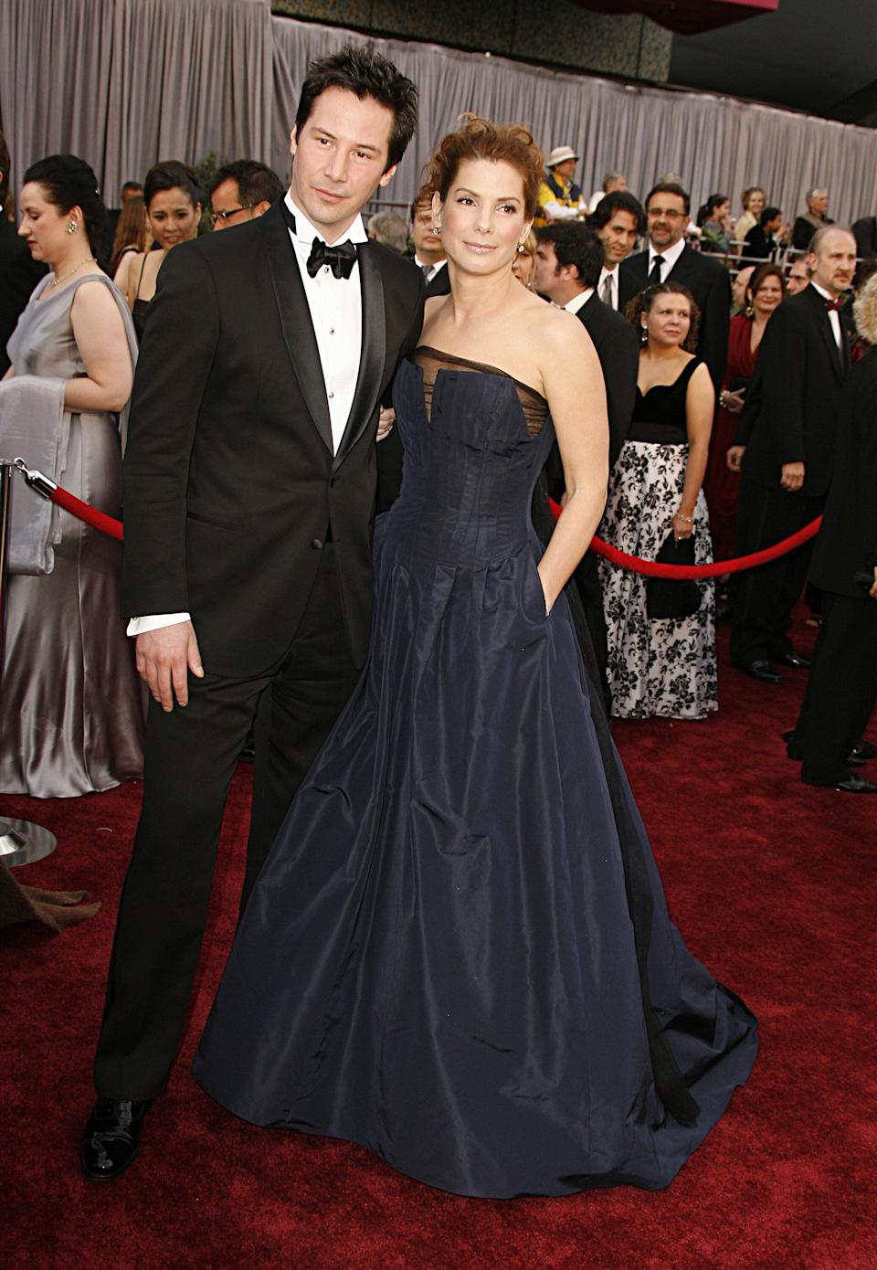 Reeves and Sandra Bullock arrive at the 78th Annual Academy Awards at the Kodak Theatre in Hollywood.