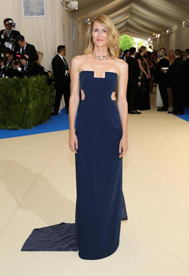 <p>Laura Dern wore a steel blue strapless gown that featured cutouts at the waist and neckline. (Photo by Neilson Barnard/Getty Images) </p>
