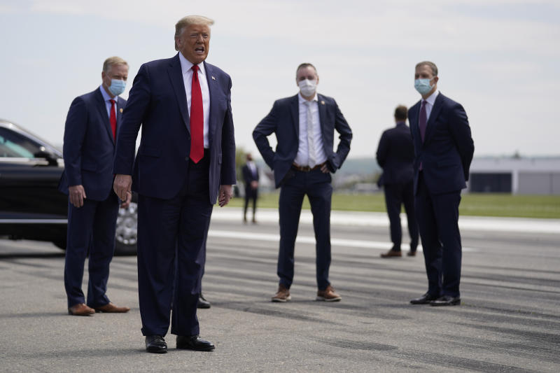 FILE - In this May 14, 2020 file photo, President Donald Trump speaks after exiting Air Force One at Lehigh Valley International Airport in Allentown, Pa. From the U.S. president to the British prime minister's top aide and far beyond, leading officials around the world are refusing to wear masks or breaking confinement rules meant to protect their populations from the coronavirus and slow the pandemic. While some are punished when they're caught, or publicly repent, others shrug off the violations as if the rules don't apply to them. (AP Photo/Evan Vucci, File)