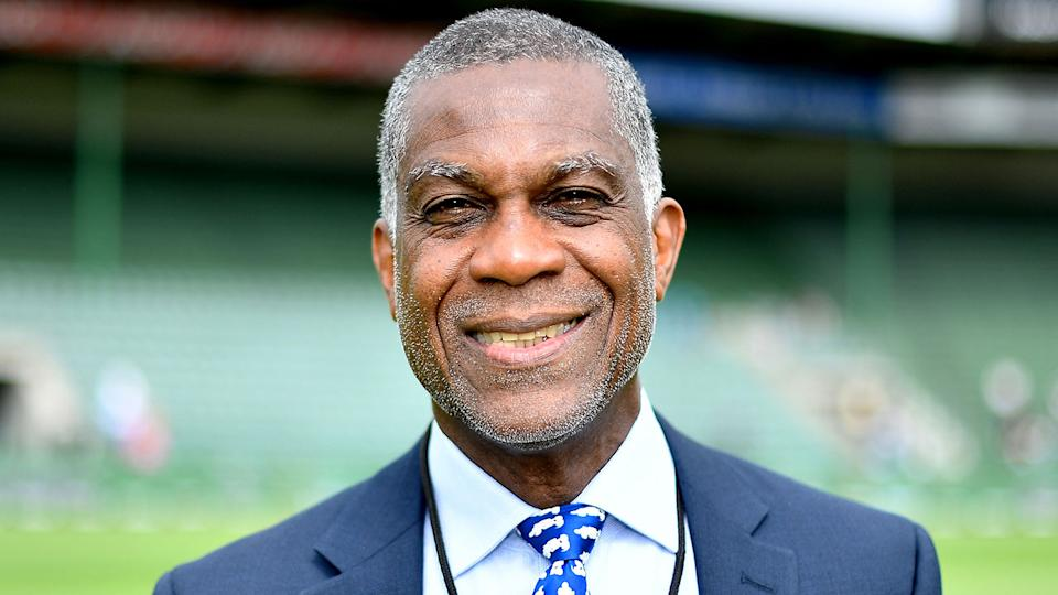 Pictured here, Michael Holding performs his duties as a cricket commentator.