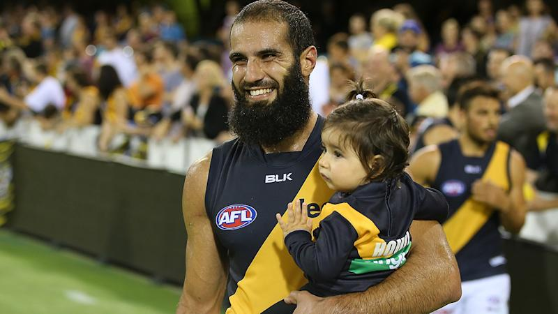 Bachar Houli, pictured here with his daughter before a Richmond game.