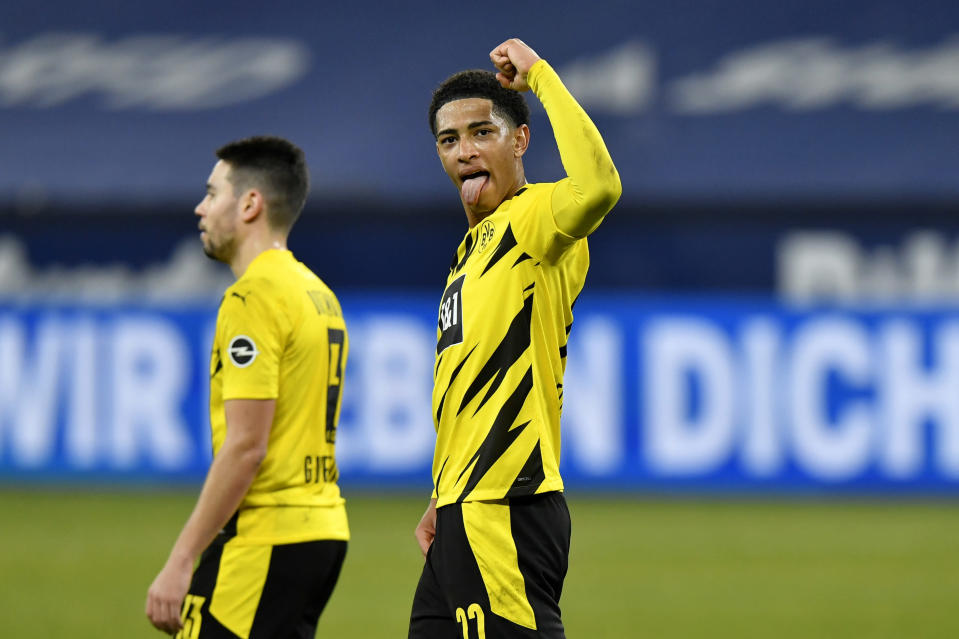 Dortmund's Jude Bellingham celebrates at the end of the German Bundesliga soccer match between FC Schalke 04 and Borussia Dortmund in Gelsenkirchen, Germany, Saturday, Feb. 20, 2021. Dortmund won 4-0. (AP Photo/Martin Meissner, Pool)