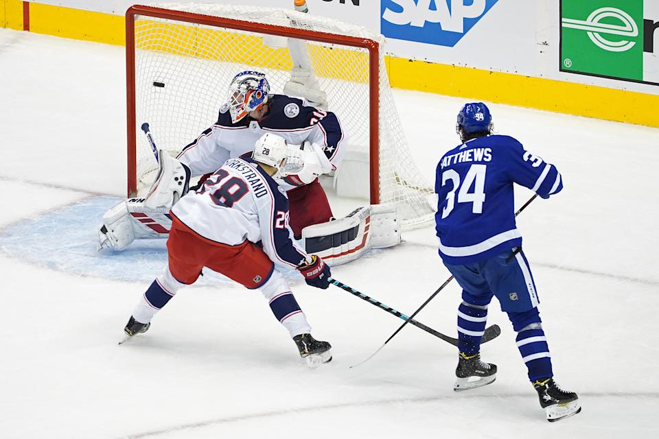 TORONTO, ONTARIO - AUGUST 04:  Auston Matthews #34 of the Toronto Maple Leafs scores a goal past Joonas Korpisalo #70 of the Columbus Blue Jackets during the second period in Game Two of the Eastern Conference Qualification Round prior to the 2020 NHL Stanley Cup Playoff at Scotiabank Arena on August 04, 2020 in Toronto, Ontario, Canada. (Photo by Andre Ringuette/Freestyle Photo/Getty Images)