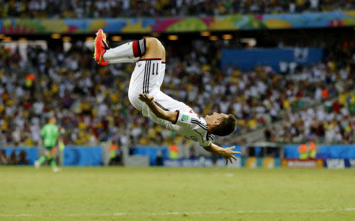 FILE - In this Saturday, June 21, 2014 file photo, Germany's Miroslav Klose performs a flip as he celebrates after scoring his sides second goal during the group G World Cup soccer match between Germany and Ghana at the Arena Castelao in Fortaleza, Brazil. On Wednesday, June 20, 2018 Cristiano Ronaldo scoring the only goal in Portugal's match against Morocco at the World Cup, Ronaldo became Europe's all-time leading goal-scorer with 85, overtaking Hungarian great Ferenc Puskas _ a star at Real Madrid, just like Ronaldo. (AP Photo/Frank Augstein, File)