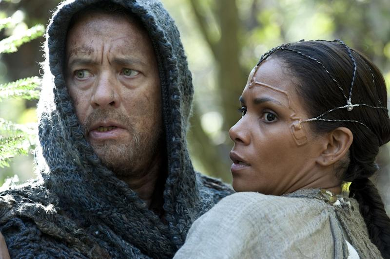 """This film image released by Warner Bros. Pictures shows Tom Hanks as Zachry and Halle Berry as Meronym in a scene from """"Cloud Atlas,"""" an epic spanning centuries and genres. The film is an epic of shifting genres and intersecting souls that features Tom Hanks, Halle Berry, Jim Broadbent, Hugh Grant, Hugo Weaving, Ben Whishaw, Jim Sturgess, James D'Arcy, Doona Bae, Keith David, Sarandon and others in multiple roles spanning the centuries. (AP Photo/Warner Bros. Pictures, Jay Maidment)"""