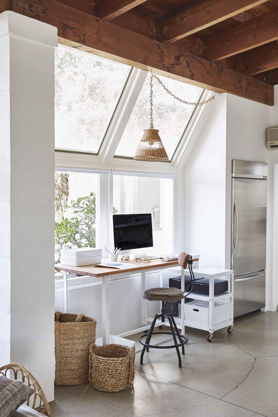 """<p>Photographer <a href=""""https://www.housebeautiful.com/design-inspiration/house-tours/a25647642/victoria-pearson-santa-barbara-house-tour/"""" rel=""""nofollow noopener"""" target=""""_blank"""" data-ylk=""""slk:Victoria Pearson"""" class=""""link rapid-noclick-resp"""">Victoria Pearson</a> combined a wooden top from Ikea and a wheeled CB2 base to create her own rolling desk, which allows for an easy change of scenery or workspace rearranging at a moment's notice. </p>"""
