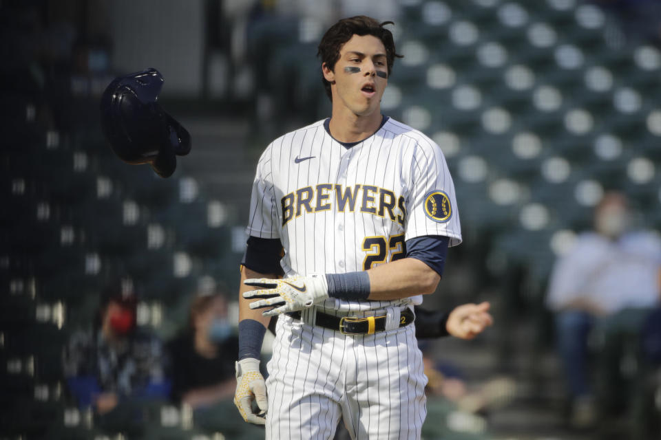 Milwaukee Brewers' Christian Yelich tosses his helmet after striking out during the seventh inning of a baseball game against the Minnesota Twins Sunday, April 4, 2021, in Milwaukee. (AP Photo/Aaron Gash)