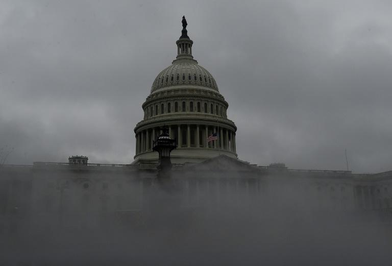 The US Capitol is shrouded in steam and fog during the second impeachment trial of former President Donald Trump in Washington, DC, February 11, 2021