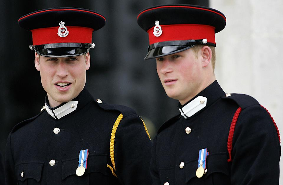 Sandhurst, UNITED KINGDOM: (FILES) This picture taken 12 April 2006 at the Royal Military Academy in Sandhurst, southern England, shows Britain's Prince Harry (R) and his brother Prince William attending the Sovereign's Parade. Prince Harry is to serve in Iraq with his regiment the Blues and Royals, the Ministry of Defence said 22 February 2007. The 22-year-old, who is third in line to the throne, is a second lieutenant in the regiment, which will deploy to Iraq in May and June for six to seven months. He is the first British royal to see active service for 25 years. AFP PHOTO FILES/CARL DE SOUZA (Photo credit should read CARL DE SOUZA/AFP via Getty Images)