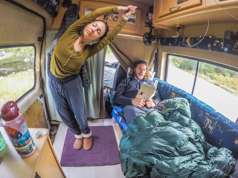Brittany and Drew relaxing inside their van the day after summiting the highest peak in Norway, August 2017. (Photo: Courtesy of Mr. and Mrs. Adventure)