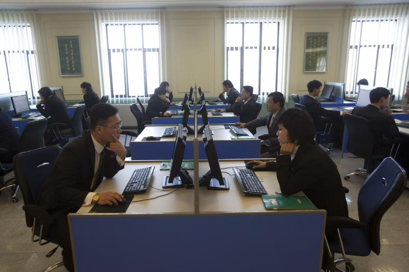 North Korean students work at computer terminals inside a computer lab at Kim Il Sung University in Pyongyang, North Korea on Tuesday, Jan. 8, 2013 during a tour by Executive Chairman of Google, Eric Schmidt. Schmidt is the highest-profile U.S. executive to visit North Korea - a country with notoriously restrictive online policies - since young leader Kim Jong Un took power a year ago. (AP Photo/David Guttenfelder)