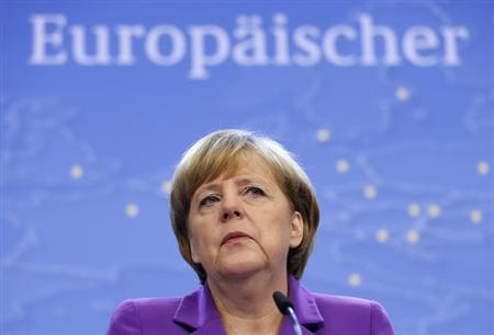 Germany's Chancellor Merkel addresses a news conference during a EU leaders summit in Brussels