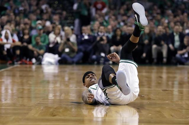 <p>Boston Celtics guard Isaiah Thomas ends up on his back after a collision during the first quarter of Game 7 of a second-round NBA basketball playoff series against the Washington Wizards, Monday, May 15, 2017, in Boston. (AP Photo/Charles Krupa) </p>