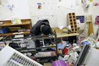 Loss: Thandie Johnson weeps inside her looted store at the Diepkloof shopping mall
