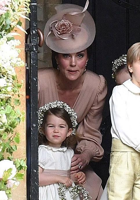 Duchess Kate's young children, Prince George and Princess Charlotte, served as page boy and bridesmaid at the wedding. Source: Getty