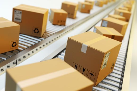 Packages moving down a conveyor for shipping.