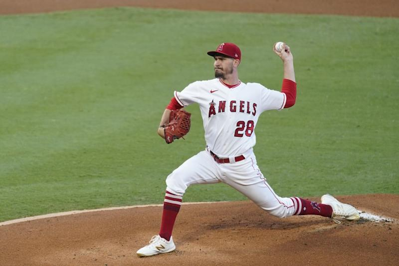 Los Angeles Angels starting pitcher Andrew Heaney throws during the first inning of a baseball game.